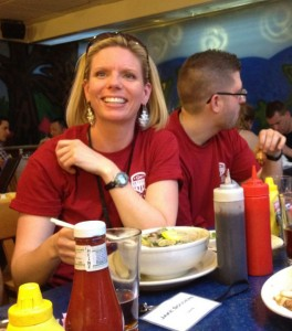 "Theresa Hilsdon, a Navy vet and senior at Georgetown University, eats pho at ""Froggy Bottom"" after volunteering at the Veterans' Day of Service at George Washington University. Photo by Leigh Giangreco"