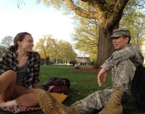Ryden Ishida (right) relaxes on American University's quad with his friend, AU senior Leah Fantle. Photo by Leigh Giangreco